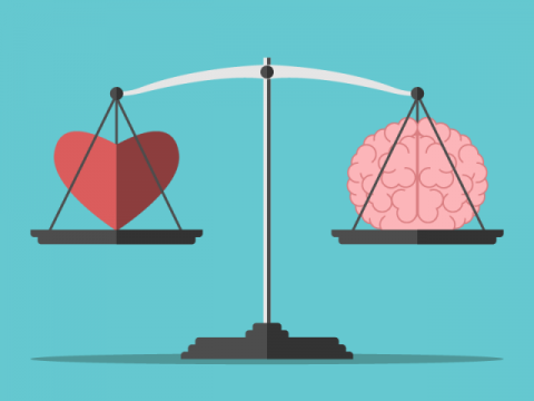 An illustration of a heart and a brain balanced on a weighing scale in front of a blue background.