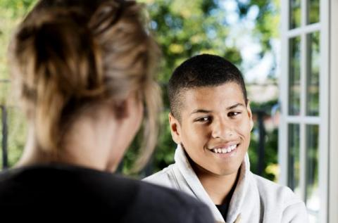 a boy communicating with another person
